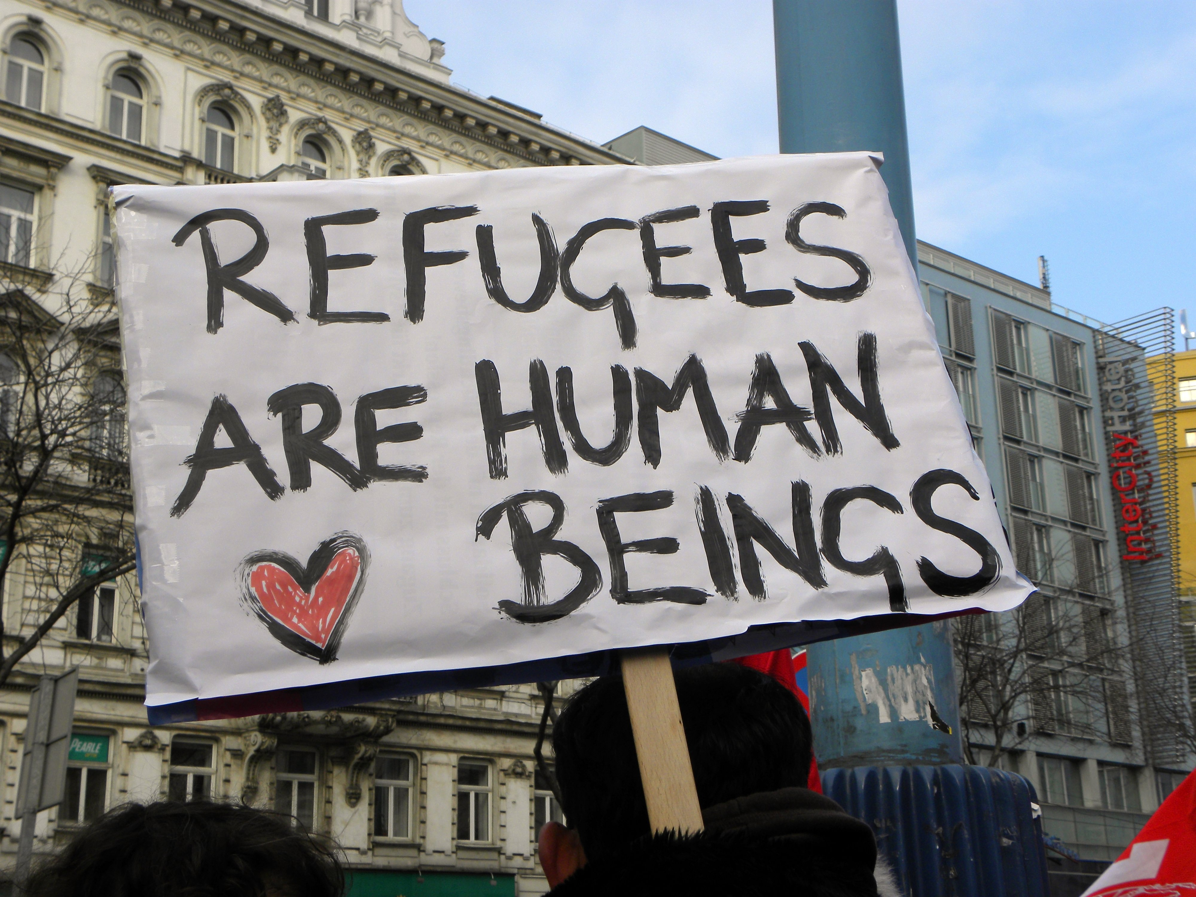 What is the difference between a 'refugee' and a 'migrant'?